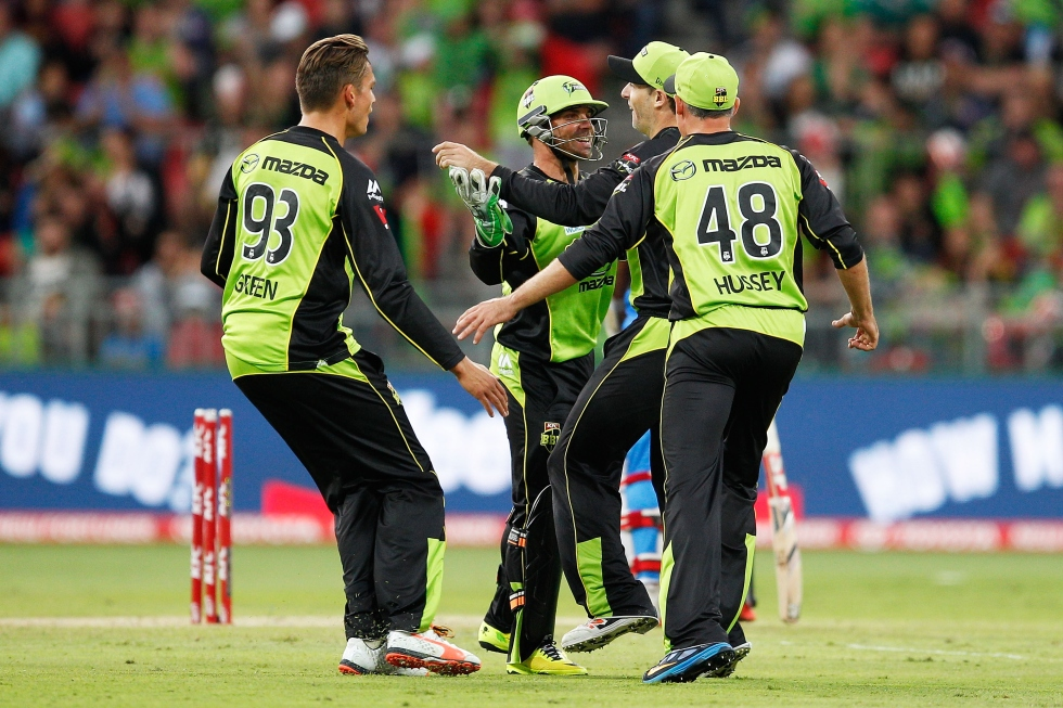 SYDNEY, AUSTRALIA - DECEMBER 28:  Ben Rohrer of the Thunder celebrates with team mates after running out Mahela Jayawardene of the Strikers during the Big Bash League match between the Sydney Thunder and Adelaide Strikers at Spotless Stadium on December 28, 2015 in Sydney, Australia.  (Photo by Brendon Thorne/Getty Images)