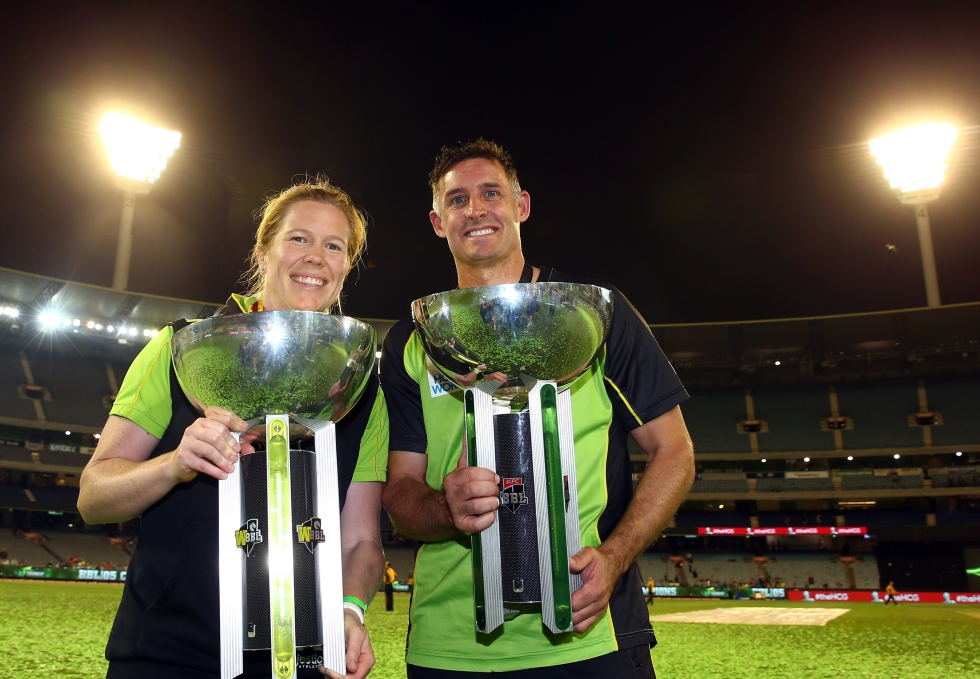 MELBOURNE, AUSTRALIA - JANUARY 24: Alex Blackwell of the Sydney Thunder women's team and Mike Hussey of the Sydney Thunder pose with the winners trophies after the Big Bash League final match between Melbourne Stars and the Sydney Thunder at Melbourne Cricket Ground on January 24, 2016 in Melbourne, Australia.  (Photo by Robert Cianflone - CA/Cricket Australia/Getty Images)